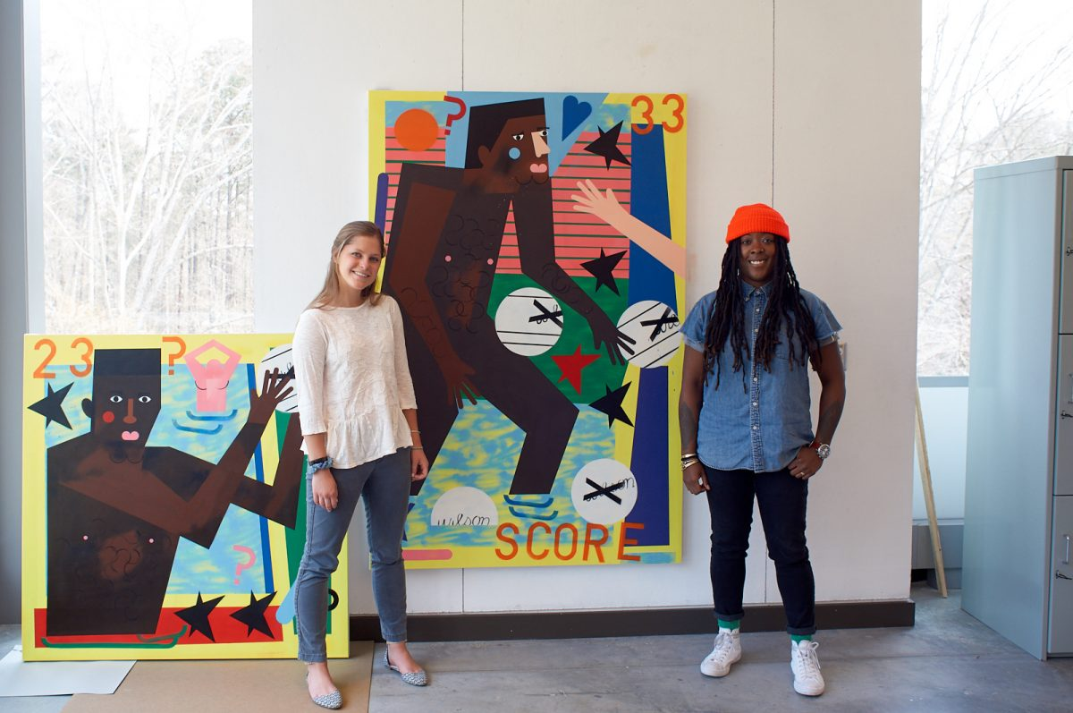 Annie Kornack poses with Nina Chanel Abney in front of new work.