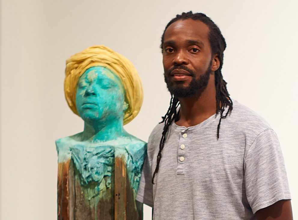 Stephen Hayes with one of his sculptures