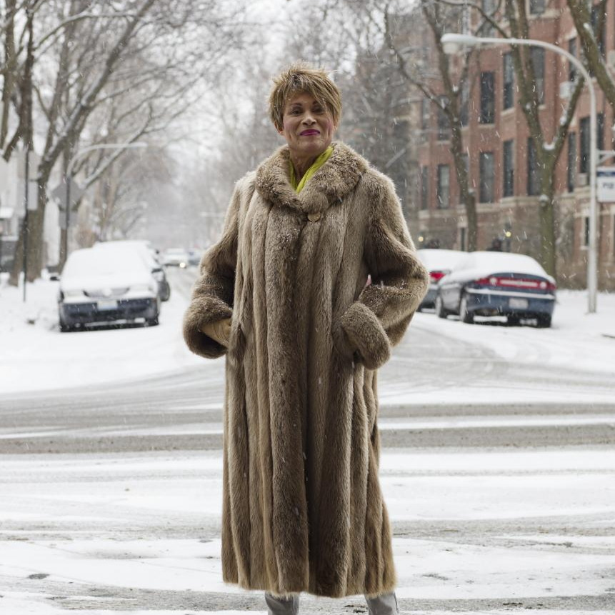 Photo of Gloria in a long fur coat